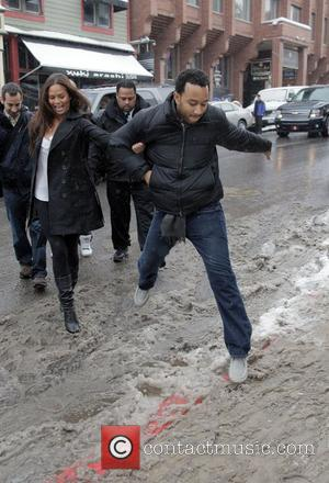 John Legend 2008 Sundance Film Festival, Day 5 John Legend holds on to a friend as he leaps to avoid...