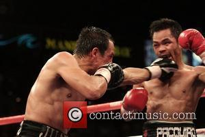 Manny Pacquiao (right) from General Santos City, Philippines won the WBC and the Ring Magazine Super Featherweight tile over Mexico's...