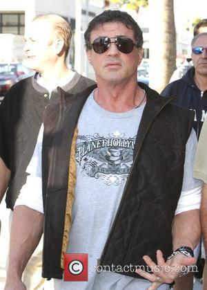 Sylvester Stallone walking around Beverly Hills where he bumps into Tom Arnorld Los Angeles, California - 16.02.08