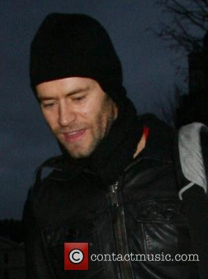 Howard Donald of boyband Take That leaving his hotel to join his fellow band mates on board a �1.7 million...