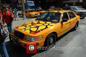 Volunteers from paint colorful flowers onto New York City's iconic yellow taxicabs to honor Mayor Bloomberg's 'Garden in Transit' community...