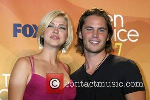 Adrianne Palicki and Taylor Kitsch
