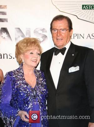 Debbie Reynolds and Sir Roger Moore