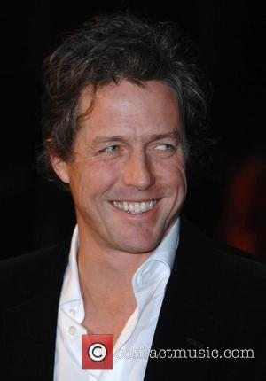 Hugh Grant Arrested After Altercation With Photographer