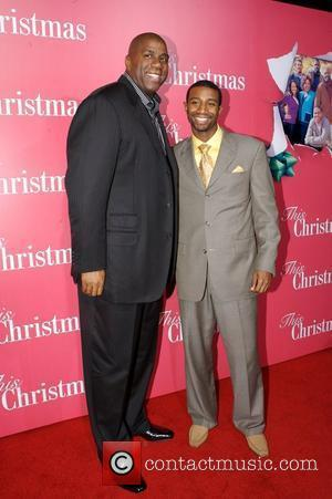 Magic Johnson and his son Andre Johnson Screen Gems presents the World Premiere of 'This Christmas' held at the Cinerama...