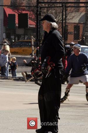 Tim Robbins playing hockey in Soho New York City, USA - 29.03.08