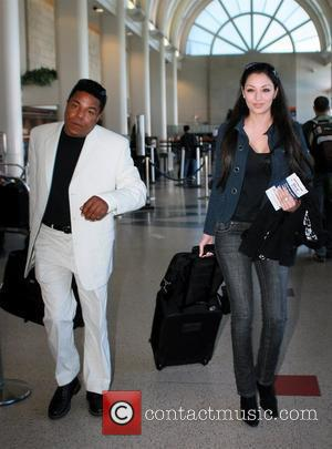 Tito Jackson  with his girlfriend arriving LAX he was in a great mood as he passed through security Los...