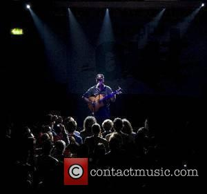 Political and social activist, Tom Morello, 'The Nightwatchman' ,performs for the Bring The Troops Home gig at the Scala, Kings...
