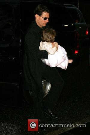 Tom Cruise and Daughter Suri Cruise Outside Their Manhattan Hotel