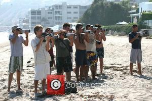 Photographers line up for Tori Spelling filming on Malibu Beach. Malibu, California - 15.07.07