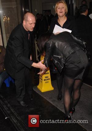 Emma Griffiths Slips On The Wet Floor