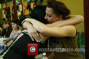 Amanda Palmer of The Dresden Dolls hugs a fan backstage The first annual True Colors Tour to support The Human...