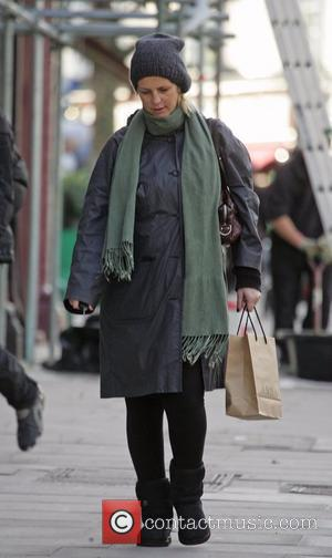 Ulrika Jonsson wraps up against the cold while out and about in London London, England - 18.01.08