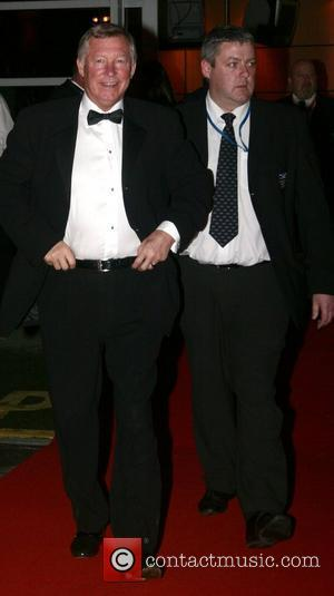 Alex Furgusson and guest Unicef gala dinner 07 at Old Trafford Stadium - Departures Manchester, England - 28.10.07
