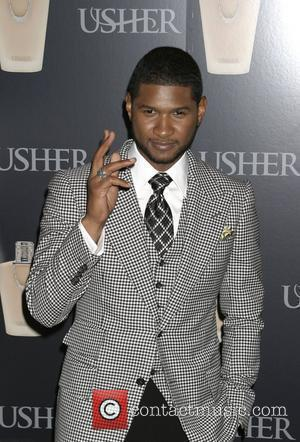 Usher Rages At Media For Taking Aim At His Wife