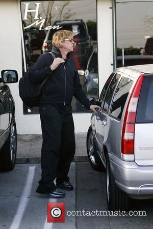 Val Kilmer leaving Sushiya restaurant on Sunset Strip wearing black sweats and carrying a backpack Los Angeles, California - 05.03.08