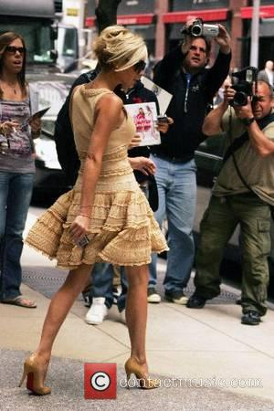 Victoria Beckham leaves her hotel for a busy day debuting her fashion line in New York City New York City,...