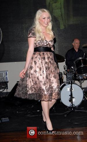 Victoria Hart promotes her debut album, 'Whatever Happened To Romance?' with a live performance at HMV Oxford Street London, England...