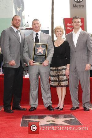 Triple H, Vince McMahon and wife, Shane McMahon Vince McMahon honoured with the 2357th Star on the Hollywood Walk Of...
