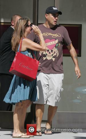 Vinnie Jones wearing his Hollywood FC baseball cap spends time with wife Tanya Jones. He currently has seven films in...