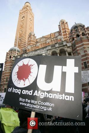 A placard is held aloft outside Westminster cathedral Protestors were demonstrating against the continued military occupation of Iraq, while Tony...