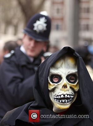 A protester wears a mask of a skull outside Westminster cathedral Protestors were demonstrating against the continued military occupation of...