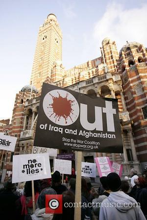Protesters hold a placard outside Westminster cathedral Protestors were demonstrating against the continued military occupation of Iraq, while Tony Blair...