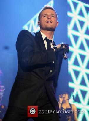 picture: nicky byrne from westlife performing at manchester arena ...