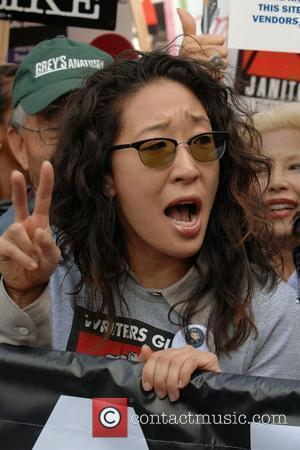 Grey's Anatomy's Sandra Oh Celebrities help support the Writers Guild America West solidarity march in Hollywood Los Angeles, California -...