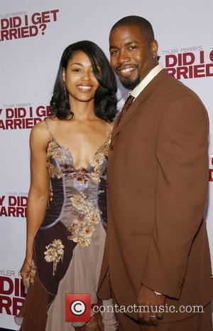 Michael Jai White and Guest World film premiere of 'Why Did I Get Married?' held at Arclight Theatre - Arrivals...