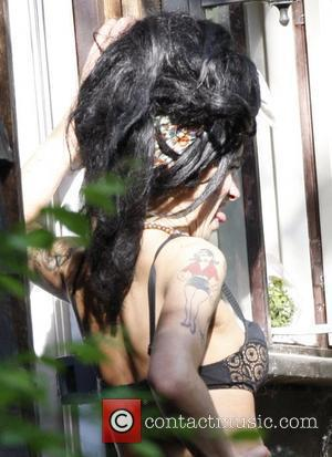 Winehouse Hotel Room 'Searched For Drugs'