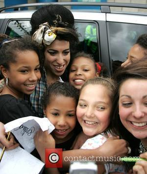 Amy Winehouse arrives at Millwall football club to watch Pete Doherty play in the Soccer Six charity game London, England...