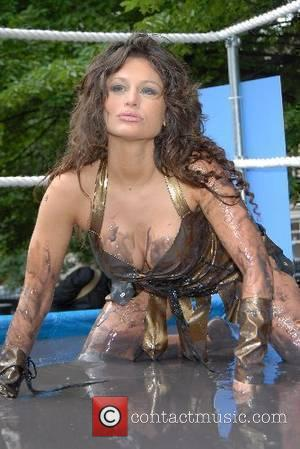 Emily Clark Brit glamour girls dress up in Xena: Warrior Princess outfits and fight it out in a mud wrestling...