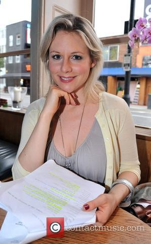 Abi Titmuss  reads the script for the 'The Spare Room Project' which she be performing in at the Etcetera...