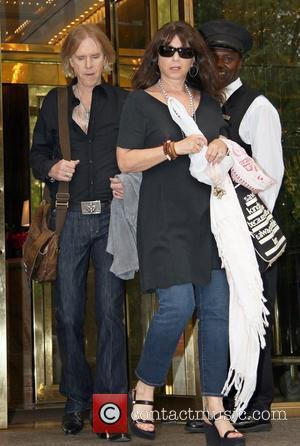 Tom Hamilton and wife Terry Cohen guitarist of legendary band Aerosmith leaving his Manhattan hotel New York City, USA -...