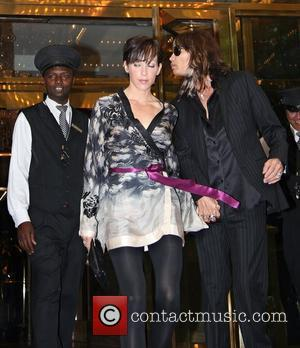 Erin Brady and Steven Tyler lead singer of legendary band Aerosmith leaving his Manhattan hotel New York City, USA -...