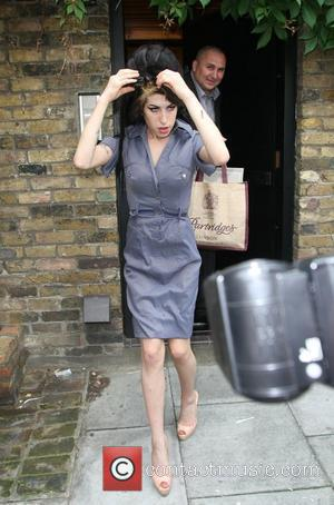 Winehouse Chops Off Her Trademark Beehive