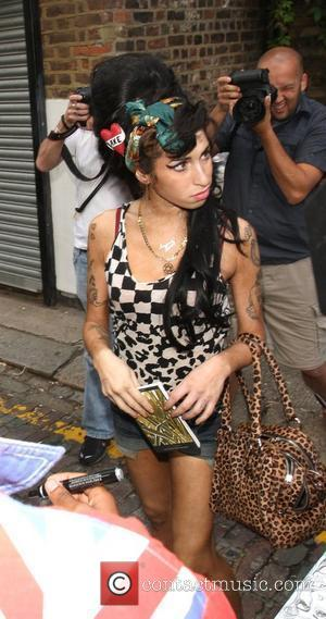 Amy Winehouse leaves her house accompanied by a minder and heads to the Jewish shopping area of London, Golders Green....