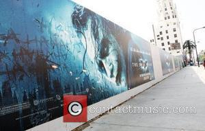 The Dark Knight movie posters located on Hollywood Boulevard and Highland Avenue promotes the late Heath Ledger in his last...