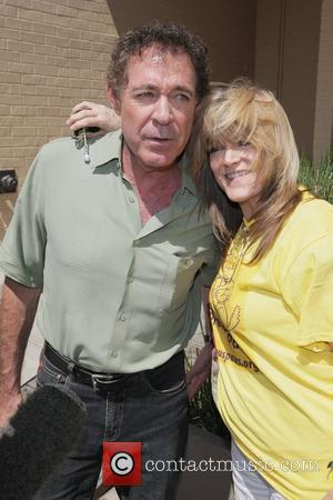 Barry Williams and Susan Olsen of 'The Brady Bunch' outline the importance of pet adoption to the media on Robertson...