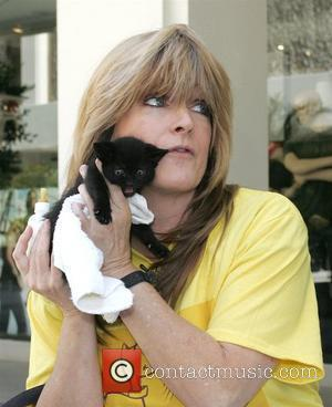 Susan Olsen of 'The Brady Bunch' are kicked out of The Ivy in West Hollywood for feeding their baby kittens...
