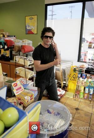 Brandon Davis stops at a petrol station on Robertson Blvd to buy cigarettes Los Angeles, California - 28.07.08