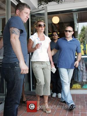 Britney Spears  carries a water bottle as she leaves Fred Segal in West Hollywood with her bodyguards Los Angeles,...
