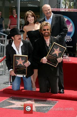 Kix Brooks and Ronnie Dunn, with Dr. Phil and Robin McGraw Brooks and Dunn receive a star on the Hollywood...