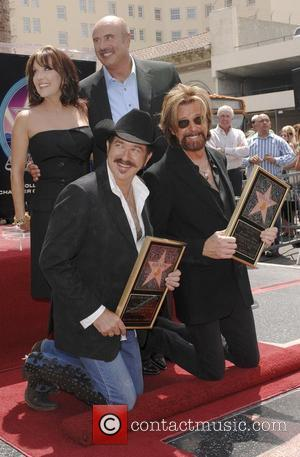 Kix Brooks and Ronnie Dunn with Robin McGraw and Dr Phil McGraw Brooks and Dunn receive a star on the...