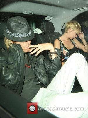 Rhys Ifans and Kimberly Stewart