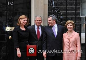 George W. Bush meets Gordon Brown at 10 Downing Street, accompanied by their wives Laura Bush and Sarah Brown. London,...