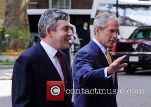 George W Bush and Gordon Brown leaving 10 Downing Street on the second day of his UK visit