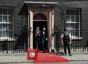George W Bush and Gordon Brown leave 10 Downing Street for a press conference at the Foreign Office