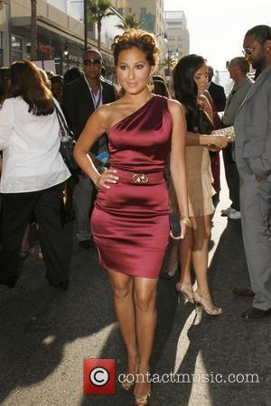Adrienne Bailon The Los Angeles Premiere of 'The Cheetah Girls One World' held at El Capitan Theatre Hollywood, California- 12.08.08